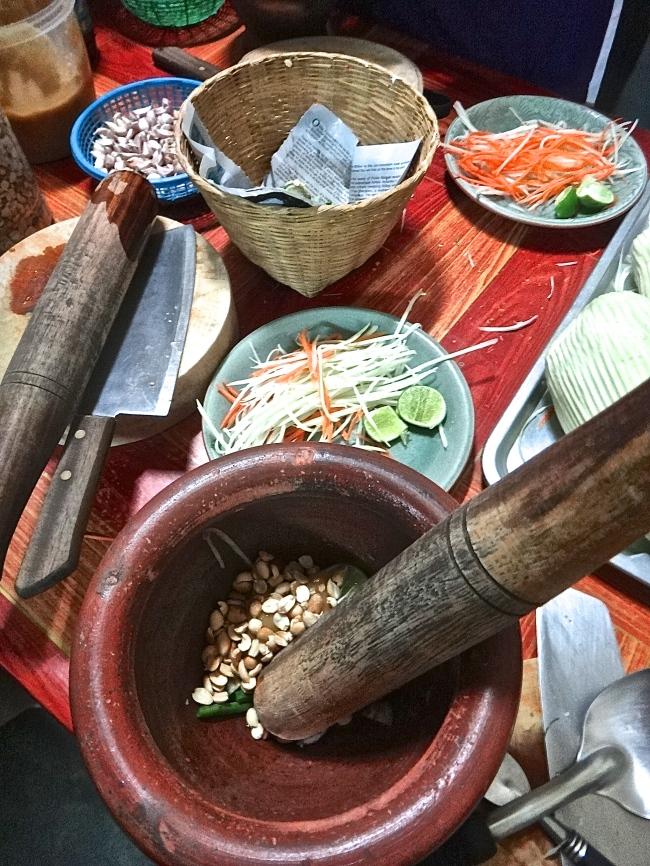 Making papaya salad in a Thai cooking class, Chiang Mai, Thailand